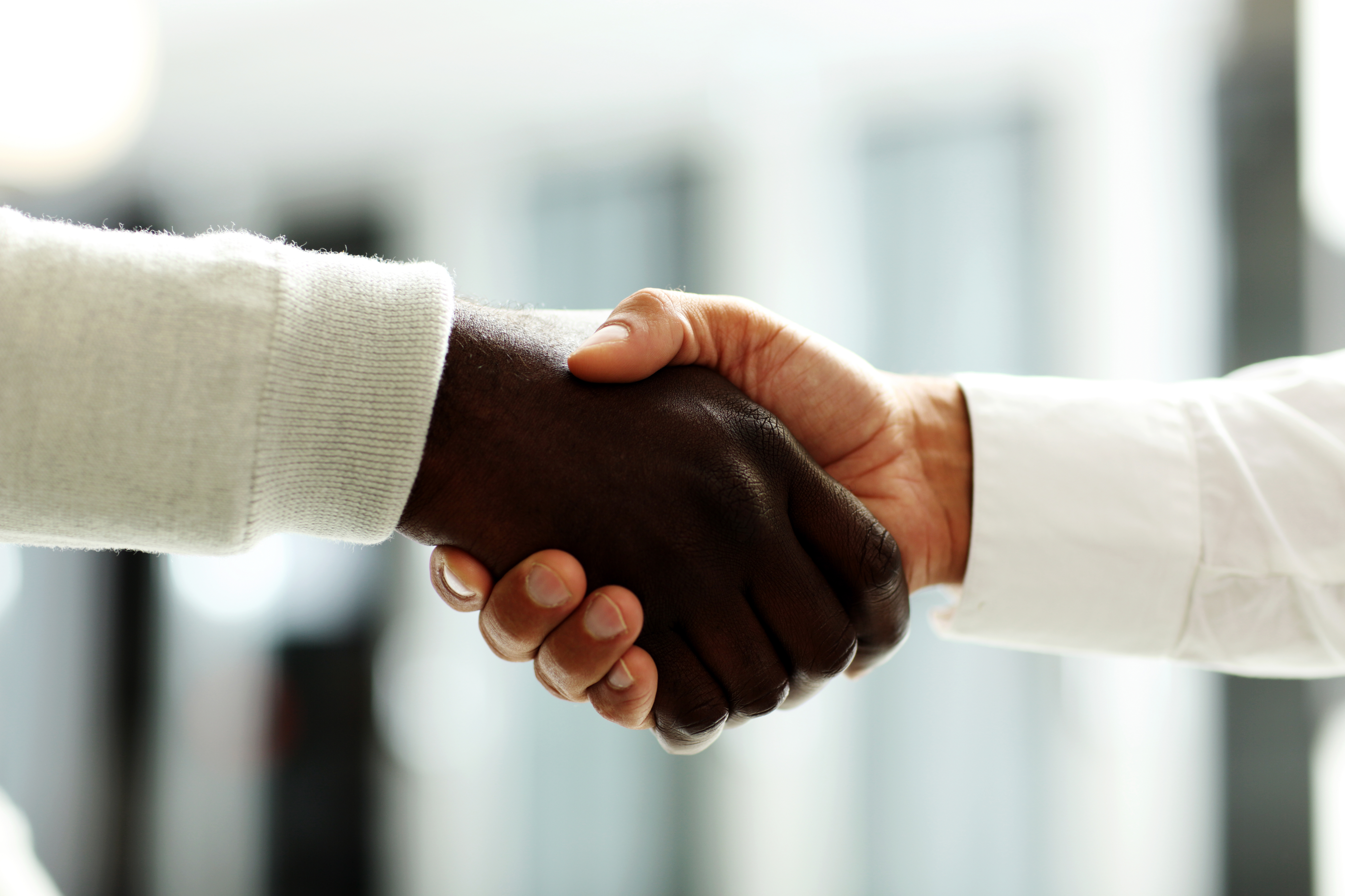 businessmen shaking hands, Caucasian and African-American